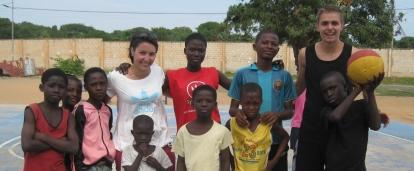 Projects Abroad volunteers teach basketball in Ghana to a group of children